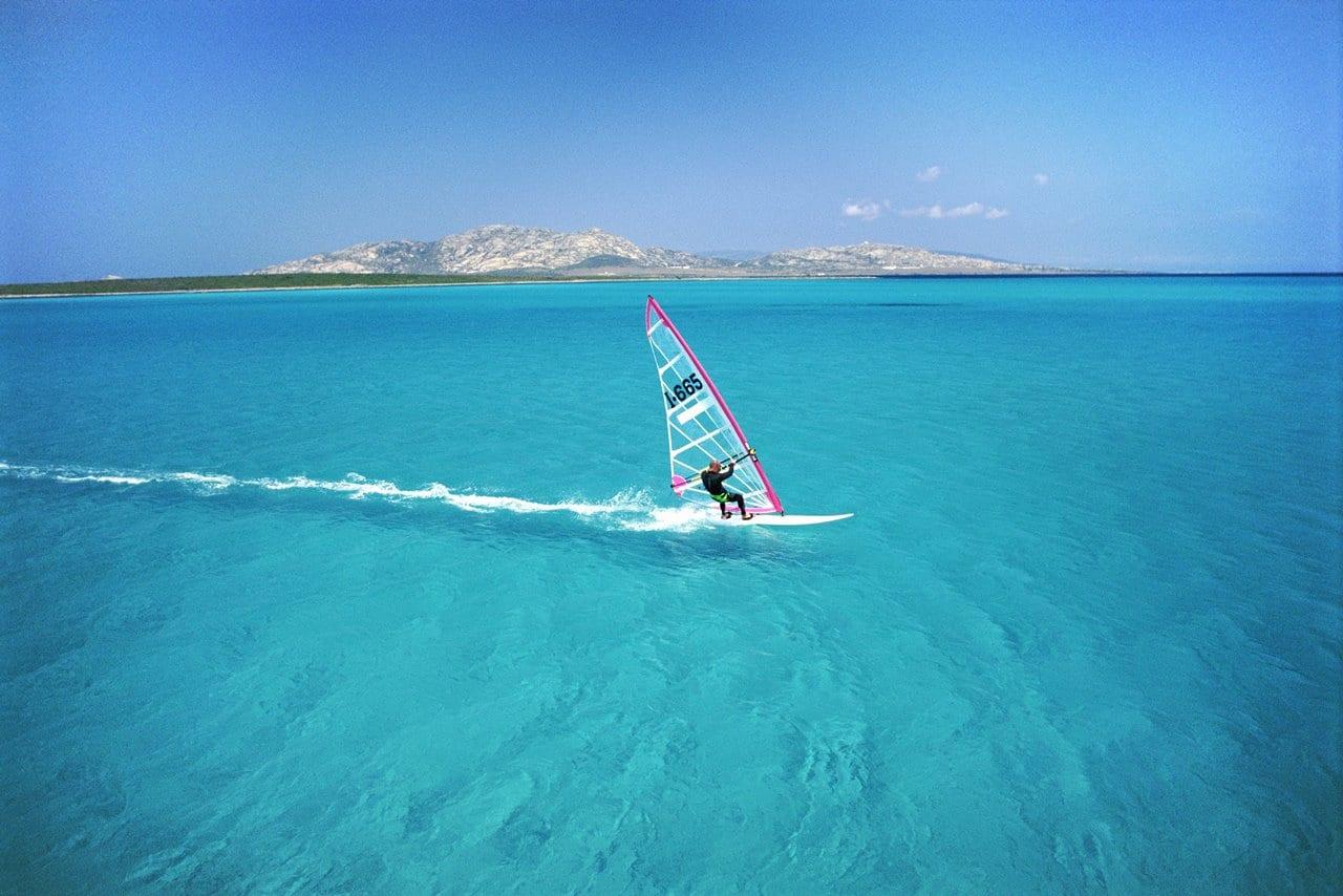 Adult Windsurfing in the Sea off the Coast of Sardinia, Italy